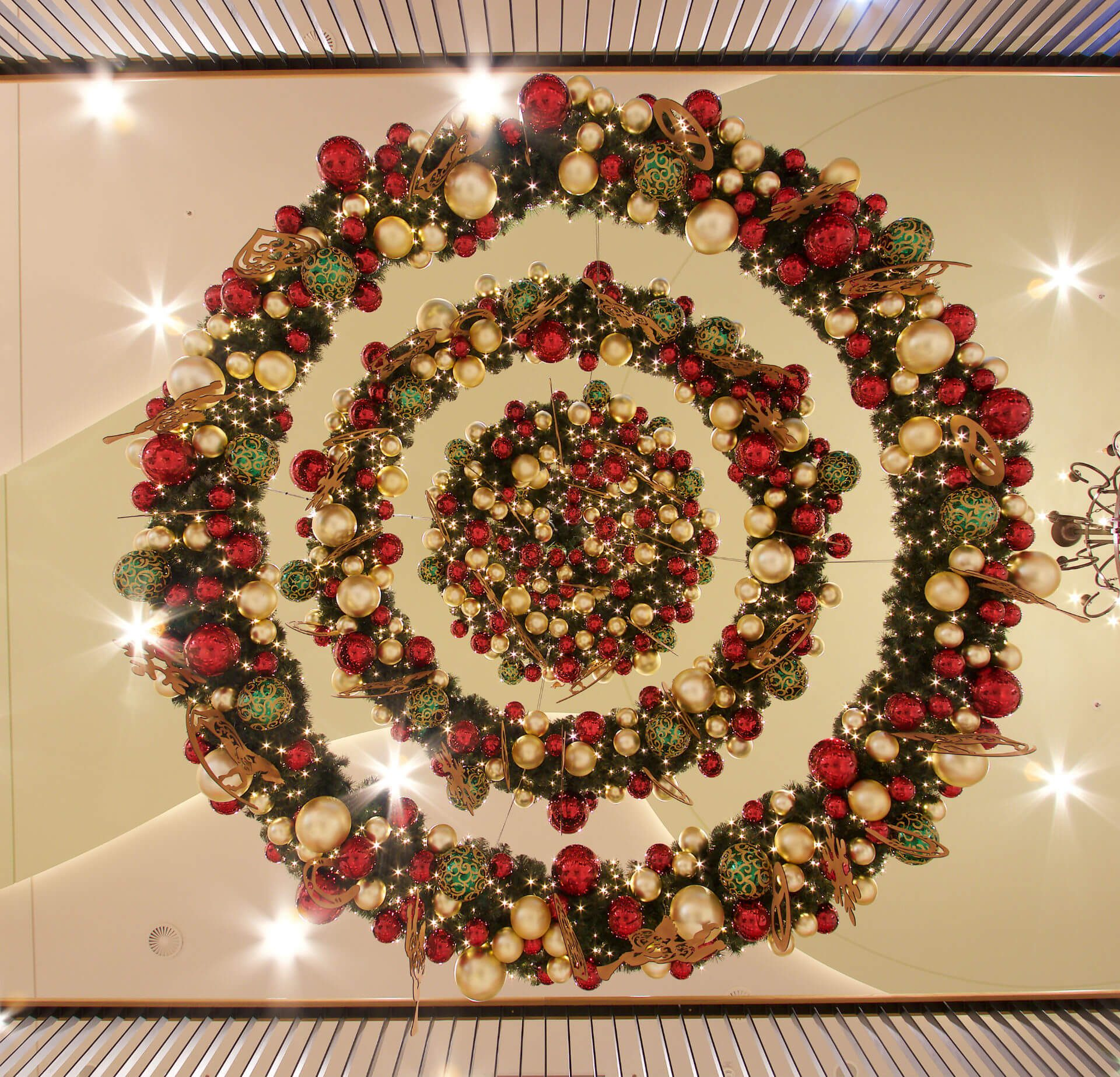 even during the daylight hours incorporating lighting and lighting effects gives giant wreaths sparkle and combining green wreaths with lights creates - Giant Christmas Hours